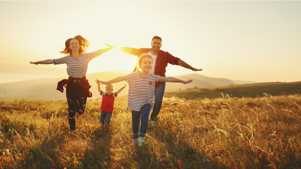 family-running-in-a-field-best-cities-in-canada-to-raise-a-family