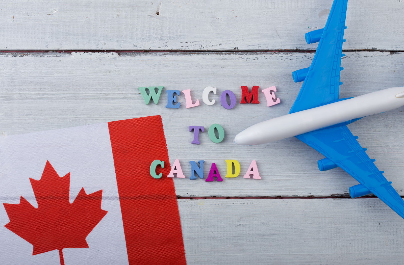 Canadian flag, plane, and Welcome to Canada wording