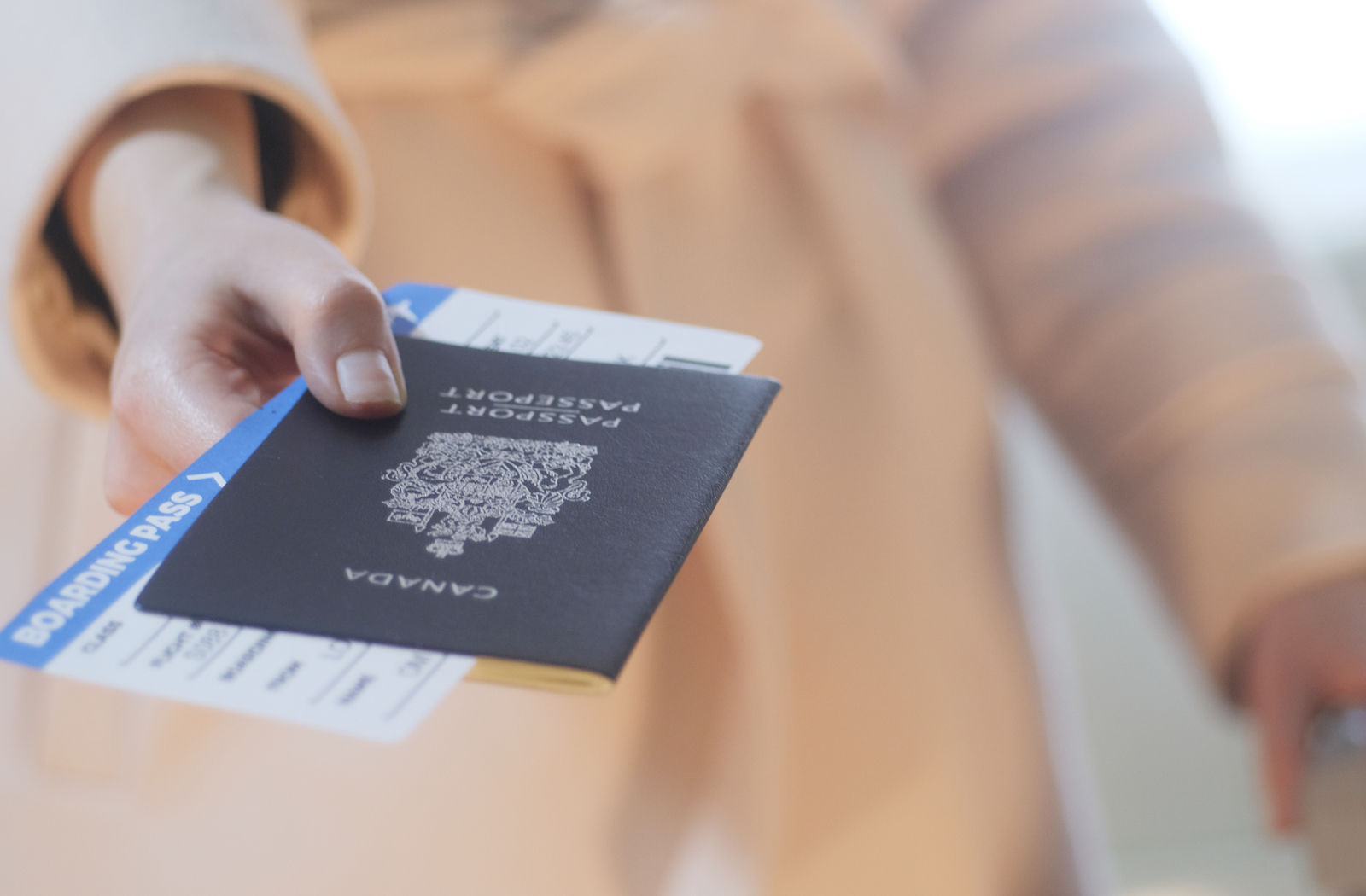 A man reaching his hand out with a passport