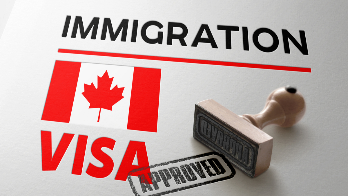 visa-immigration-approved-stamp-how-to-get-a-canadian-work-visa-from-qatar