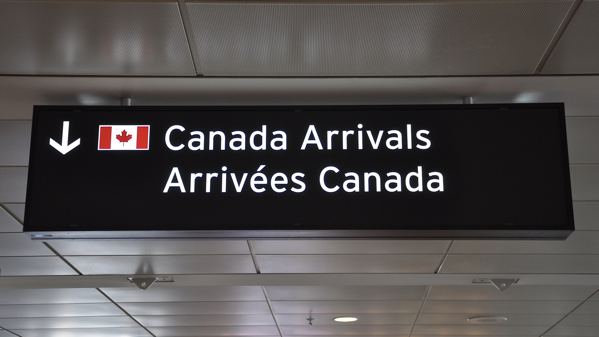 canada-arrivals-board-how-to-get-a-canadian-work-visa-from-qatar