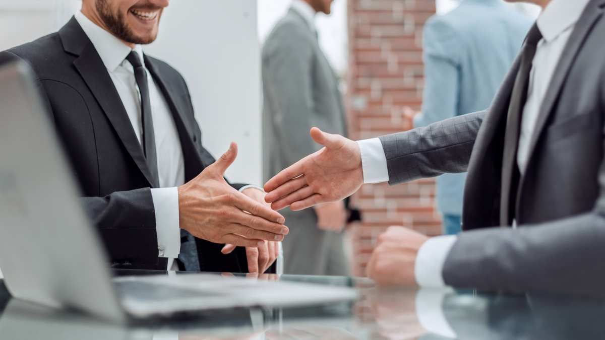 two-men-shaking-hands-in-a-meeting-how-to-get-a-job-in-canada-from-india